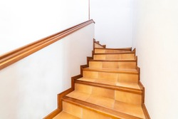 Contemporary wood stairway. Interior wooden stairs. Staircase going down. Pathway of stairway or staircase inside a house. Interior structure design concept.