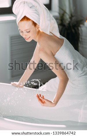 Content attractive young tourist female pampering herself with mineral water procedure in wellbeing area of spa hotel. hydrotherapeutic procedure concept. #1339864742