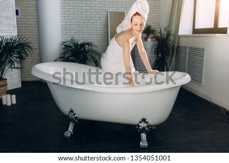 Content attractive young tourist female pampering herself with mineral water procedure in wellbeing area of spa hotel. hydrotherapeutic procedure concept. #1354051001