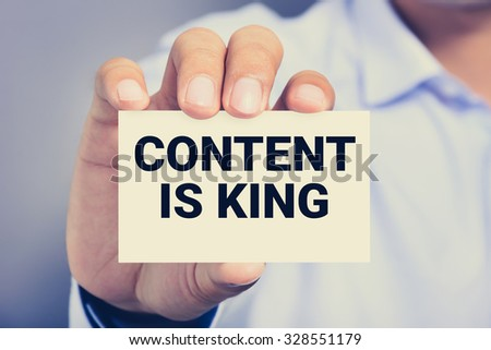 CONTENT IS KING message on the card shown by a man