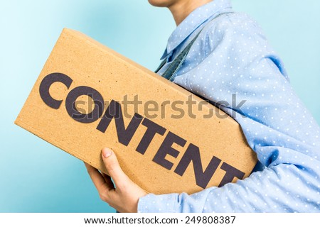 Content marketing distribution concept. Woman carrying a box with the word