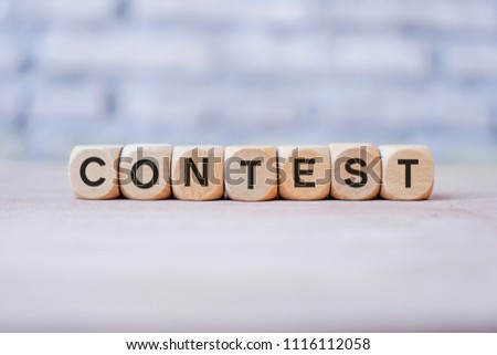 Contest word written on wood block #1116112058
