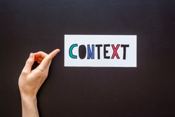 Context marketing concept. Word Context on paper banner, top view