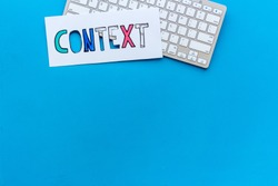Context online advertising concept. Word Context on the keyboard, top view