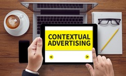 CONTEXTUAL ADVERTISING, on the tablet pc screen held by businessman hands - online, top view