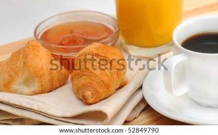 Continental breakfast - croissant, coffee, jam and orange juice