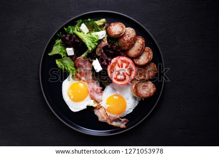 continental breakfast food, business lunch, restaurant menu, delicious nourishing morning meals, roasted eggs, sausage and salad Stockfoto ©
