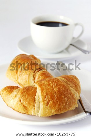 continental breakfast of coffee and croissants