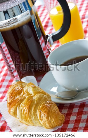 Continental breakfast with croissant, coffee cup and cafetiere