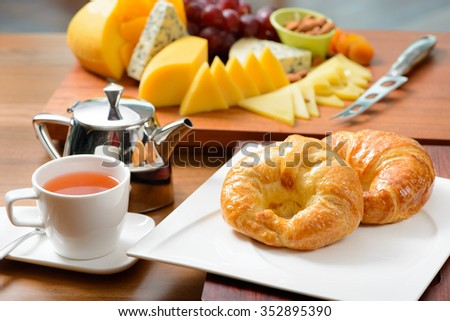 Continental breakfast with croissant, tea and cheese Stockfoto ©