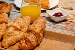 Continental Breakfast With Croissants on Rustic Table
