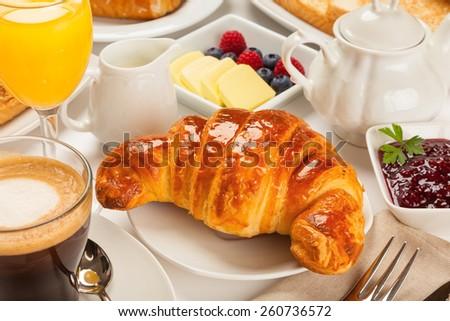 Continental breakfast with croissants, orange juice and coffee or tea Stockfoto ©