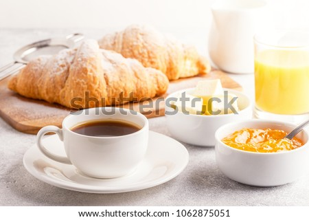 Continental breakfast with fresh croissants, orange juice and coffee, selective focuse. #1062875051