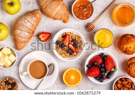 Continental breakfast with fresh croissants, orange juice and coffee, top view.