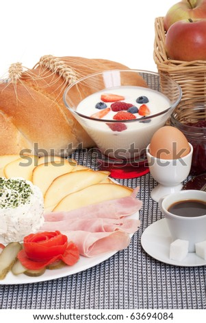 Continental breakfast with fruit, cheese, sausage and bread