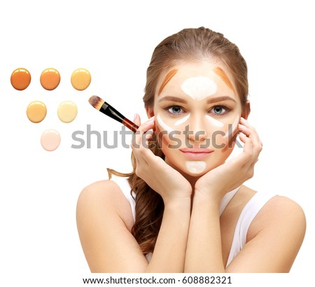 Contouring.Make up woman face. Contour and highlight makeup..Foundation on white background #608882321