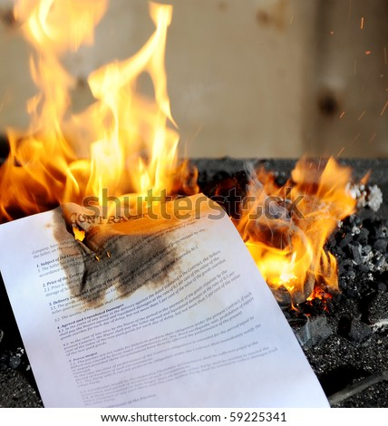 Contract burning in the fire - stock photo