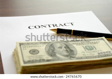 Contract page with pen and stack of dollars on table. See more like it in my portfolio.