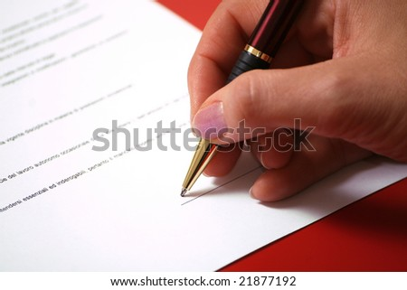 contract signature - closeup on woman hand