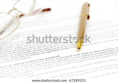 Contract with glasses and pen ready to be signed