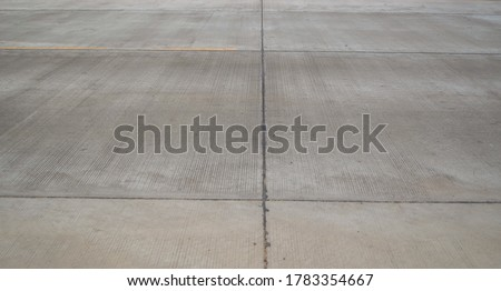 Contraction joint and longitudinal joint made by  asphalt joints sealant. Longitudinal joint on concrete pavement road construction.