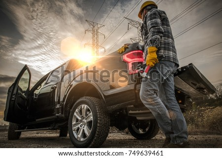 Contractor Field Research Future Construction Site. Field Work. Caucasian Worker and His Company Pickup Truck