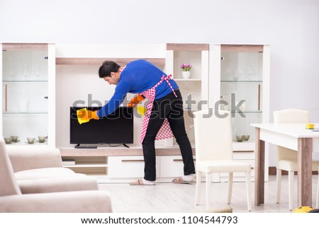 Contractor man cleaning house doing chores #1104544793