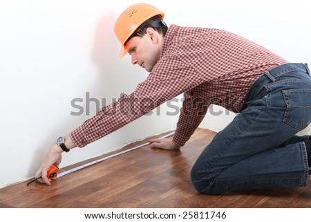 contractor measuring room - stock photo