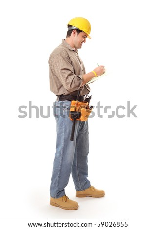 Contractor or architect builder standing full length while writing - stock photo