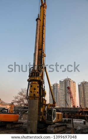 Contractors used bore pile rig machine at the construction site with building foundation work.