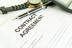 contracts agreement sign on document paper with black pen