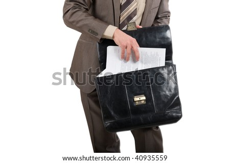 Contracts for the signature. Briefcase in hands of the businessman over white background