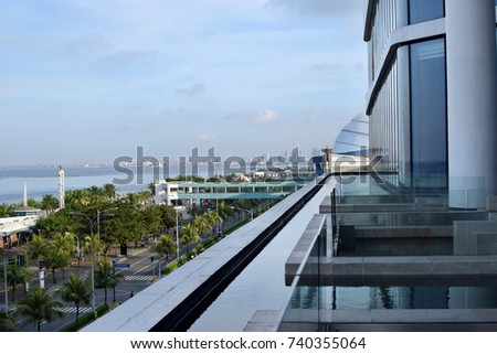 Contrad Hotel, Manila, Philippines - October 22, 2017: Building balcony surrounded by water pond overlooking ocean bay #740355064
