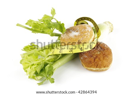Contradiction between healthy food and junk food using celery and jam dough nut with a yellow tape measure on a reflective white background