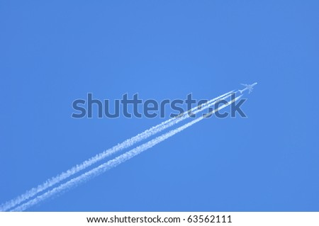 Contrails of a Jet Against a Clear Blue Sky