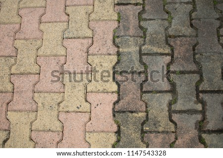 Contrast between patio paving slabs which have been pressured washed before and after cleaning #1147543328