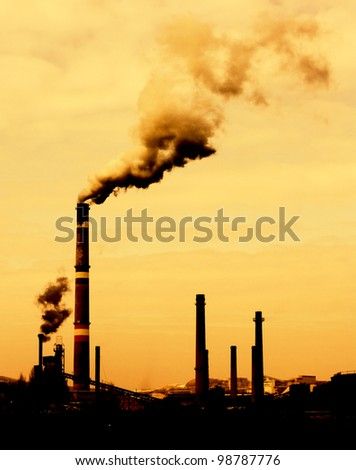 Contrast concept of global warming  in sepia.Pollution smoke from factory