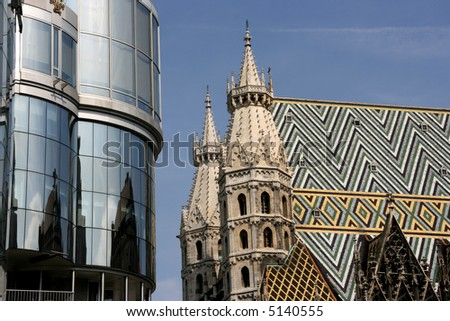 Contrast on Stephansplatz in Vienna (Austria) - new building of Haas Haus and old Gothic Cathedral (Stephansdom)