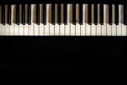 contrasted piano in black background