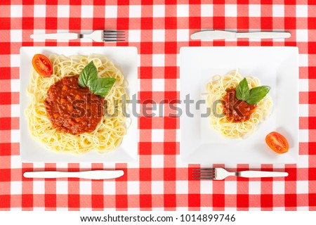 Contrasting large and tiny food portions of Spaghetti ストックフォト ©
