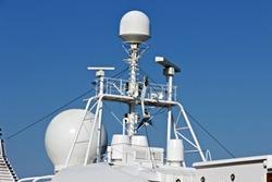 Control navigation radar set of antennas cruise ship. Cruise travel tourism concept. Radars on the top cruise liner deck blue view romantic landscape.