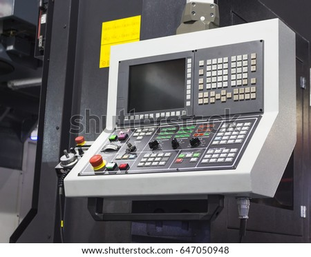 Control panel of cnc machining center. Selective focus ; mock up ; industrial background #647050948