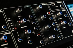 Control panel with backlight buttons and knobs. Studio DJ mixer equipment for party and convert making. Modern digital equaliser, soundboard console. Sound recording and broadcasting technology
