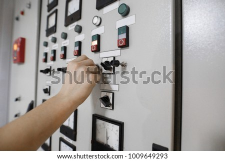 control panel with sensors the worker manages the production process voltage indicator on control panel control panel for industrial production #1009649293