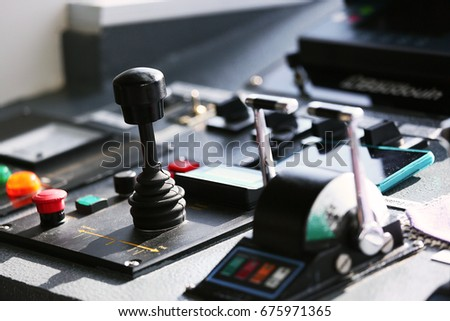 control room of vessel and operated by captain and crews boat with have a lot control function and communication with marine control. Interior of boat control room and offshore life in ocean.