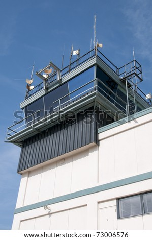 Control tower guides aircraft operations at busy airport