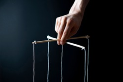 controling your mind, twisted sticks with ropes in the hand, puppet concept, isolated