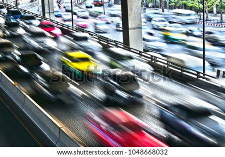 Controlled-access highway in Bangkok during rush hour.  #1048668032