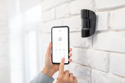 Controlling alarm system with smart phone and special mobile application wireless, holding device the motion sensor indoors