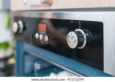 controls on the oven for a close-up